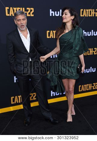 LOS ANGELES - MAY 07:  George Clooney and Amal Clooney arrives for the Hulu's 'Catch-22' US. Premiere on May 07, 2019 in Hollywood, CA
