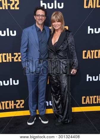 LOS ANGELES - MAY 07:  Grant Heslov and Lysa Hayland arrives for the Hulu's 'Catch-22' US. Premiere on May 07, 2019 in Hollywood, CA