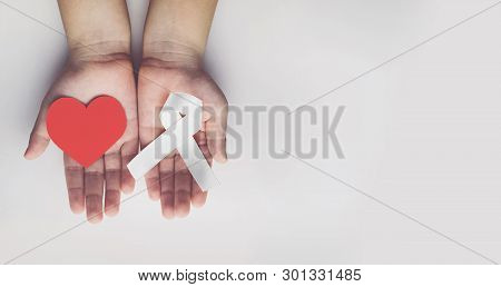 Child Holding White Ribbon. Violence Against Children And Women