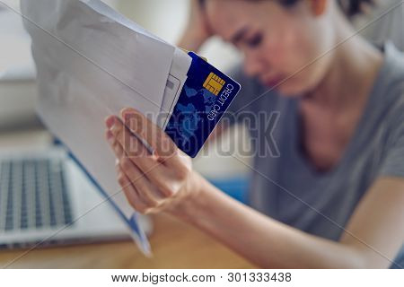 Stressed Young Sitting Asian Woman Hands Holding Credit Card And Bills Worry About Find Money To Pay