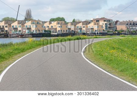 Empty Curved Road On A Dam In The Dutch Countryside, Capelle Aan Den Ijssel, Netherlands