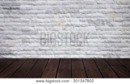Wood Shelf With White Brick Wall Textured Background.
