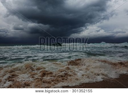 storm clouds and dramatic waves in ocean