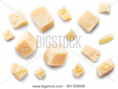 Parmesan cheese cubes and parmesan crumbs isolated on white background.