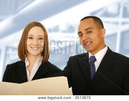 two business people holding folder and looking at the camera and smile. concept for business team poster