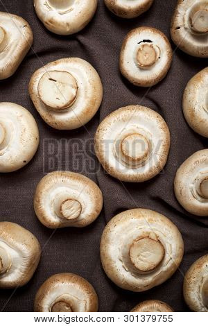 Mushrooms on a brown tablecloth