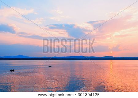 Sea landscape. Summer sunny sea scene with unidentified people in the boat, concept of summer sea vacation activities. Sea summer nature