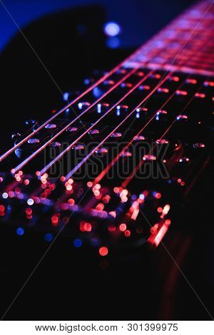 Close-up Of A Humbucker. Detail Of Six-string Electric Guitar, Soft Selective Focus. With Colorful B