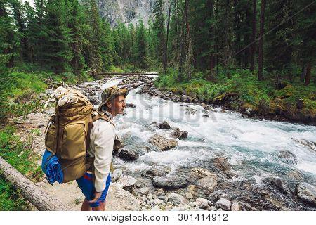 Traveler On Way Along Mountain River. Fast Water Stream In Wild Mountain Creek. Highland Landscape W