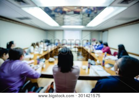 Blurry Image Of Business Conference In The Meeting Room