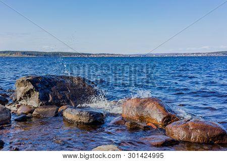 Beautiful Shore Of Lake Onega. Petrozavodsk, Karelia. Water And Stones On The Shore Of Lake Onega.