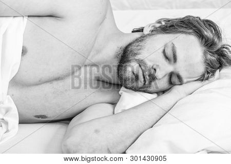 Man Handsome Guy Lay In Bed In Morning. Tips On How To Wake Up Feeling Fresh And Energetic. Morning