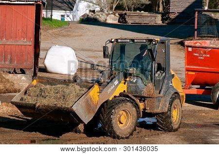 Rowley, Massachusetts, April 28, 2019: The 204k John Deere Front End Loader Hauling Silage Is A Prod