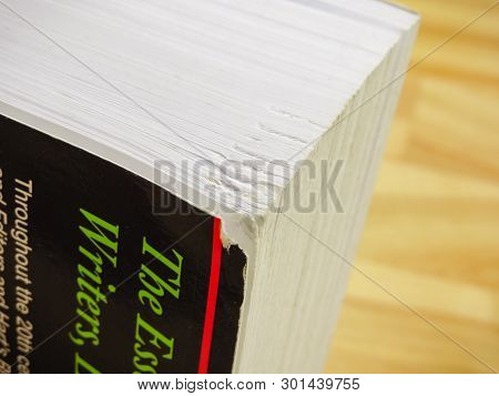 Wrexham, Uk - January 17, 2018: Damage To Corner Of A Thick Writers Paperback Book. Close Up Detail.