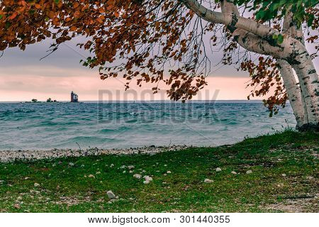 A Windy Fall Day On Mackinac Island, Looking Out At Round Island Lighthouse, With A Little Bit Of Su