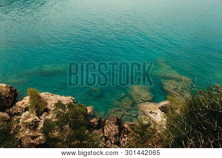 Panoramic View Of Tropical Landscape. Bay In The Mediterranean Sea With Blue Water And A Stones. On