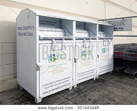 Bayamon, Puerto Rico - February 28, 2019: Storage Containers Used For Recycling Clothers, Shoes And