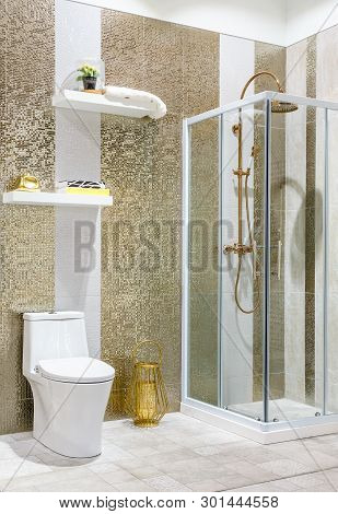 Spacious And Bright Modern Bathroom Interior With White Walls, A Shower Cabin With Glass Wall, A Toi