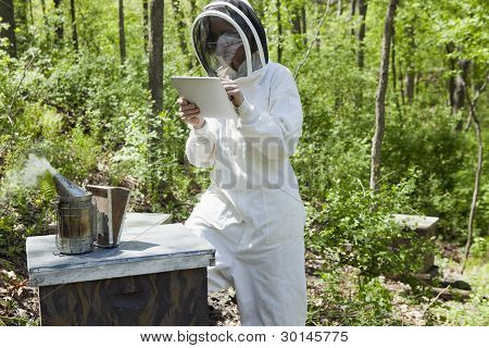 Beekeeper Using Digital Tablet