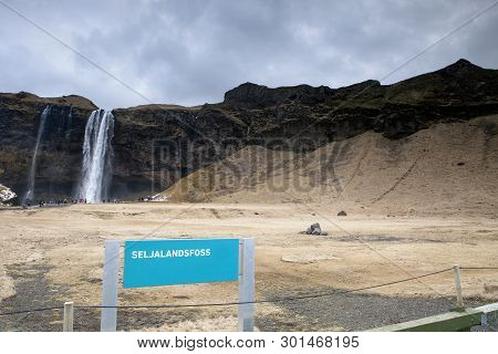 The Water Cascades Down The Mountain In Iceland