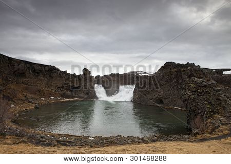A Scenic View Of The Popular Hjalparfoss Waterfall In Iceland