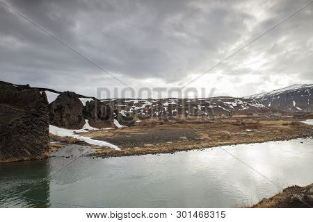 The Foss River Flows Through The Scenic Icelandic Landscape