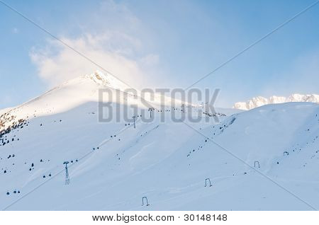 Sunrise At An Alpine Ski Piste In Winter