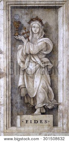 FLORENCE, ITALY - JANUARY 10, 2019: Fides, detail of Filippino Lippi's frescoes in the Strozzi Chapel of the Santa Maria Novella Principal Dominican church in Florence, Italy