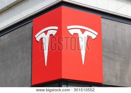 Aarhus, Denmark - May 10, 2018: Sign Of Tesla Cars On A Building Of A Dealership. Tesla Is An Americ