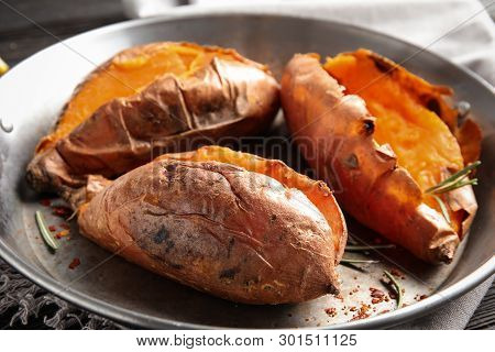Dish With Baked Sweet Potatoes On Table, Closeup