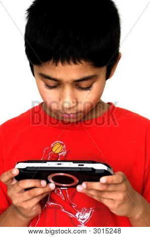 An handsome Indian kid getting addicted to video games poster