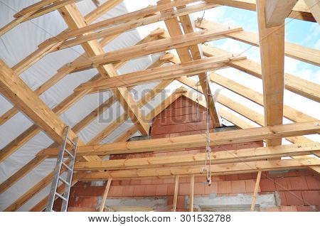 Roofing Construction, Wooden Roof Beams, Rafters, Frame House Attic Construction.