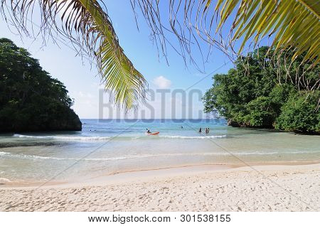 Port Antonio, Portland, Jamaica - 11th June 2017 : Beautiful view on Frenchman's Cove Beach with some tourist enjoying the water near Port Antonio, Jamaica