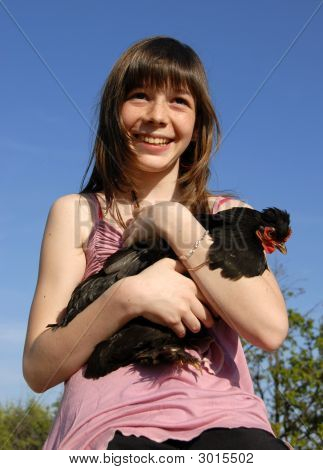 laughing girl and her little black chicken in a farm poster