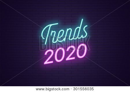 Neon Lettering Of Trends 2020. Glowing Headline, Bright Neon Cursive Text Of Trends 2020. Title Temp