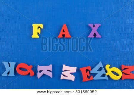 Fax Word On Blue Background Composed From Colorful Abc Alphabet Block Wooden Letters, Copy Space For