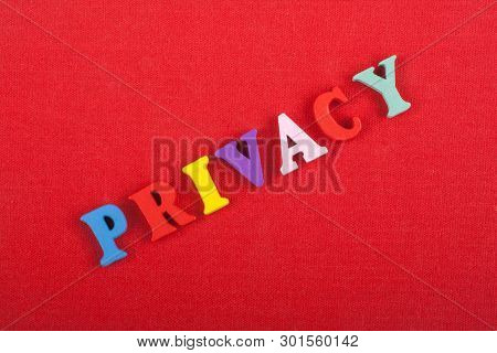 Privacy Word On Red Background Composed From Colorful Abc Alphabet Block Wooden Letters, Copy Space