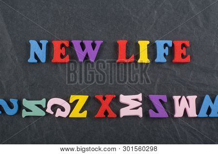 New Life Word On Black Board Background Composed From Colorful Abc Alphabet Block Wooden Letters, Co
