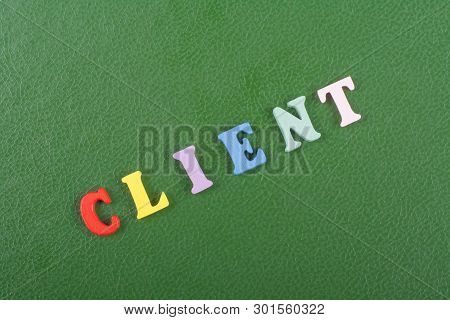 Client Word On Green Background Composed From Colorful Abc Alphabet Block Wooden Letters, Copy Space