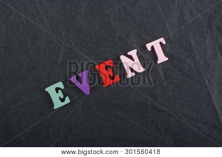 Event Word On Black Board Background Composed From Colorful Abc Alphabet Block Wooden Letters, Copy