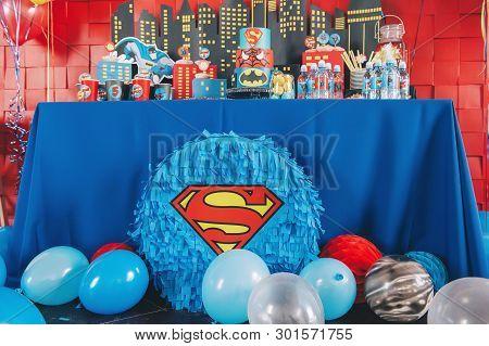 Perm/russia - April, 25, 2018: Piñata In The Form Of A Superhero At The Festive Table. Spiderman, Su