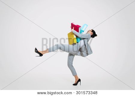 Young Woman In Suit Getting A Lot Of Work And Losing Concentration. Dropping Folders With Papers On