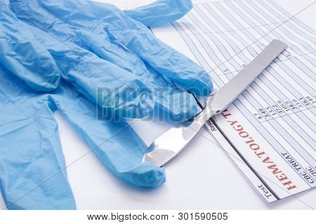 Surgical gloves, scalpel and hematology blood test result on operating table. Preparation for surgery or its completion. Physician decides about procedure based on laboratory analysis data poster
