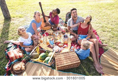 High Angle Top View Of Happy Families Having Fun With Kids At Pic Nic Barbecue Party - Multiracial L