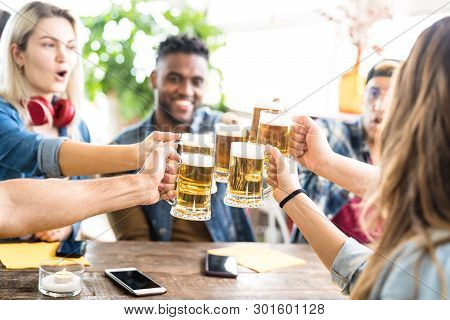 Happy Multiracial Friends Drinking And Toasting Beer At Brewery Bar - Friendship Concept With Young