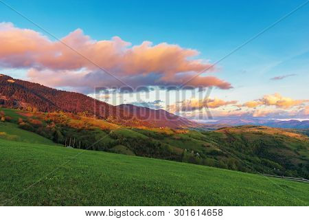 Beautiful Rural Landscape In Mountains At Dawn. Agricultural Fields On Hills. Ridge In The Distance.