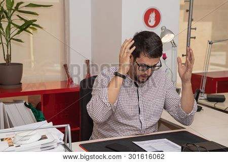 Businessman In The Office With Surprise Gesture