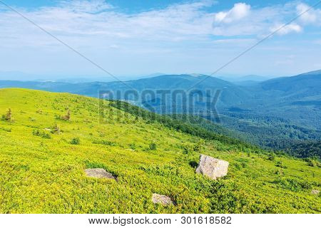 Mountain Landscape On Summer Morning. Meadows On The Hills Decorated With Big White Sharp Rocks. Bea