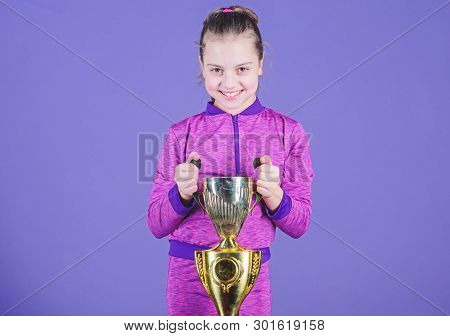 Celebrating Childrens Achievements Great And Small. Sport Achievement. Celebrate Victory. Girl Hold