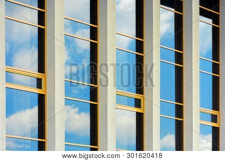 Beautiful Urban Architecture Background. Window Reflection Of A Clouds On A Blue Sky. Perspective Si